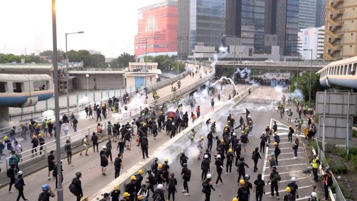 Tear Gas Fired in Hong Kong as Protesters Barricade Street Outside Police Station